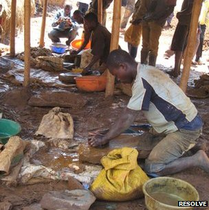Gold-laden pebbles, fresh from a mine, are crushed into silt in the Democratic Republic of Congo