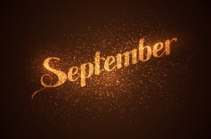 September label with glowing golden sparkles.